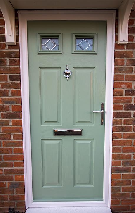 green door with lead work glazing