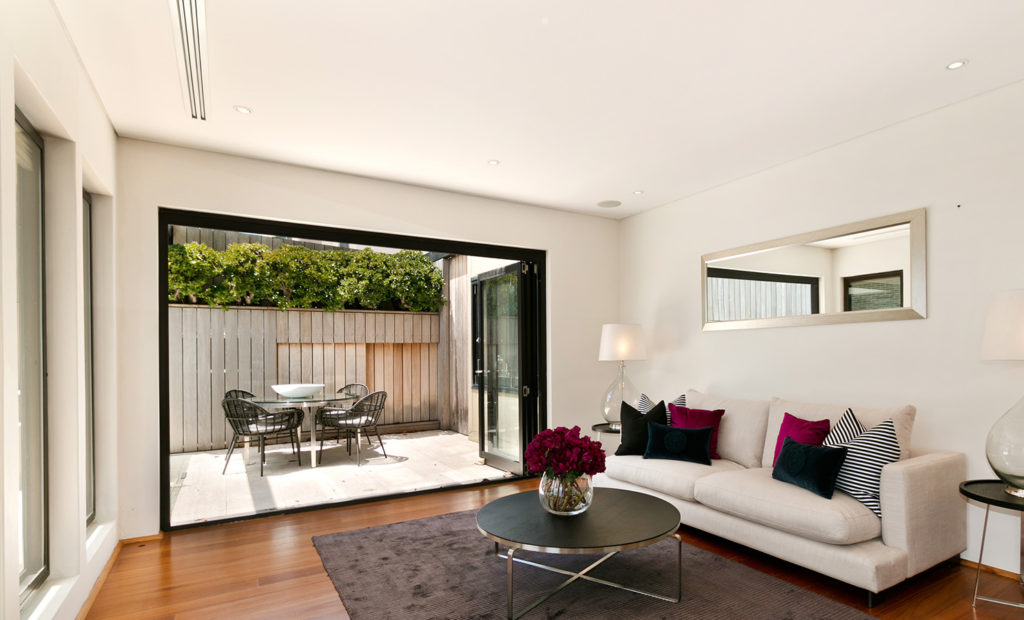 bifold doors open and leading out to patio in modern home
