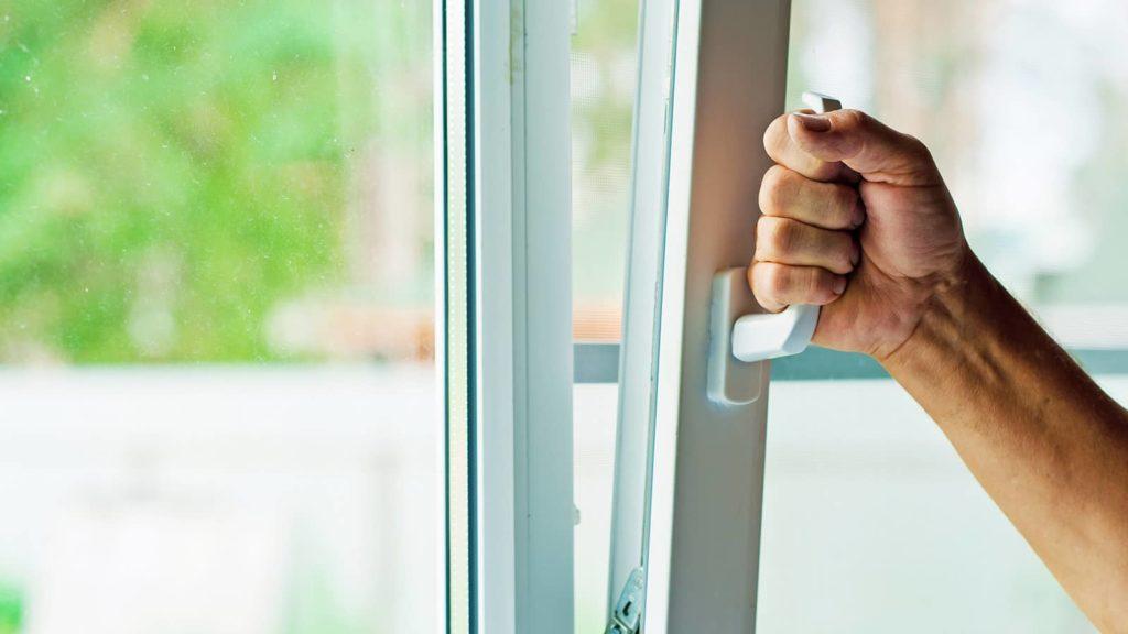 Double Glazed Window man pulling handle down